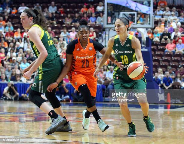 Seattle Storm forward Breanna Stewart sets a pick for Seattle Storm guard Sue Bird while she is defended by Connecticut Sun guard Alex Bentley during...