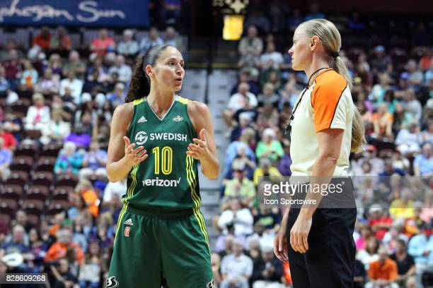 Seattle Storm guard Sue Bird and referee Tiffany Bird converse during the second half of an WNBA game between Seattle Storm and Connecticut Sun on...