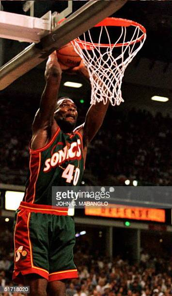 Seattle SuperSonic Shawn Kemp slams for two points against the Sacramento Kings 02 May in Sacramento California Kemp scored 23 points as his team...