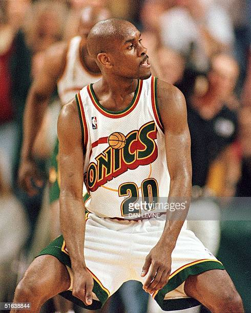 Seattle SuperSonic's Gary Payton taunts the Minnesota Timberwolves' bench after sinking a threepointshot at the buzzer in the third quarter of the...