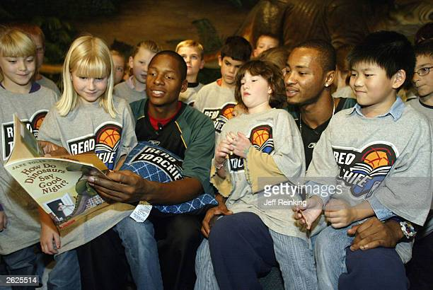 Seattle SuperSonics Ray Allen and Rashard Lewis read to students at the Pacific Science Center October 21 2003 in Seattle Washington NOTE TO USER...
