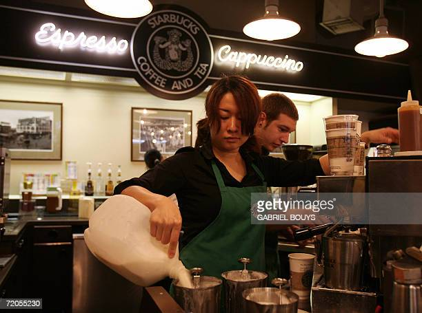 Employees prepare beverages in the first Starbucks coffee shop in Seattle 30 September 2006 Starbucks Corp said it would raise most beverage prices...