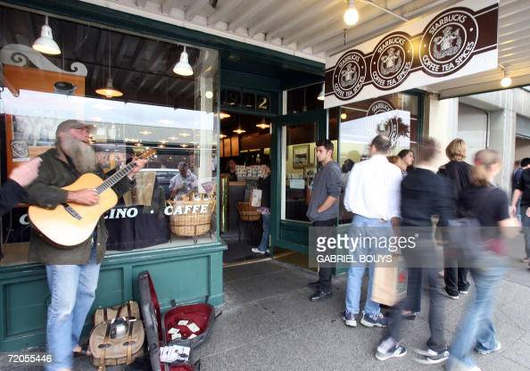 locals and tourist pass the first Starbucks coffee shop in Seattle 30 September 2006 Starbucks Corp said it would raise most beverage prices at its...