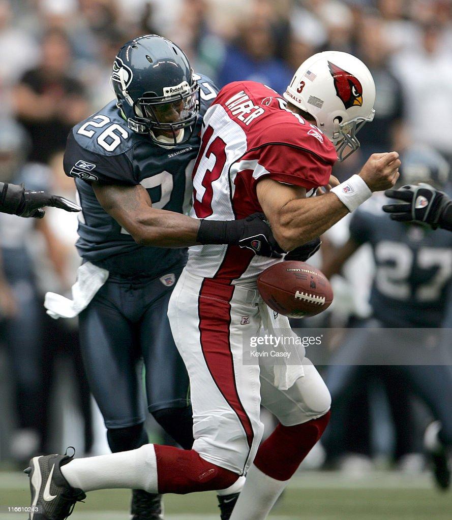 Seattle's Ken Hamlin sacks Arizona QB Kurt Warner during the first half of the Seattle Seahawks vs Arizona Cardinals NFL game at Qwest Field in...
