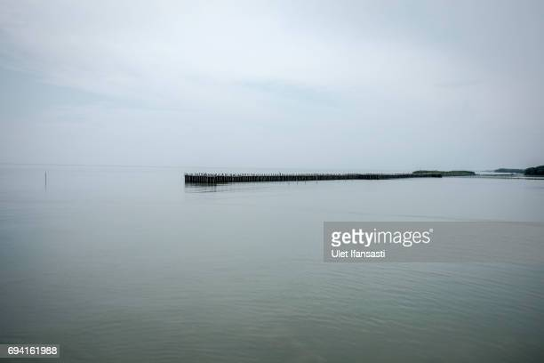 A seawall is seen at Timbulsloko village on June 7 2017 in Demak Indonesia Indonesia is known to be one of the largest archipelagic nation in the...