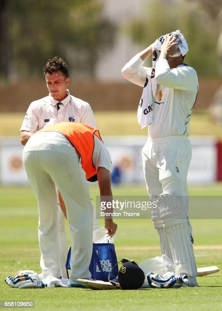 Seb Gotch and James Pattinson of the Bushrangers cool off during a drinks break during the Sheffield Shield final between Victoria and South...