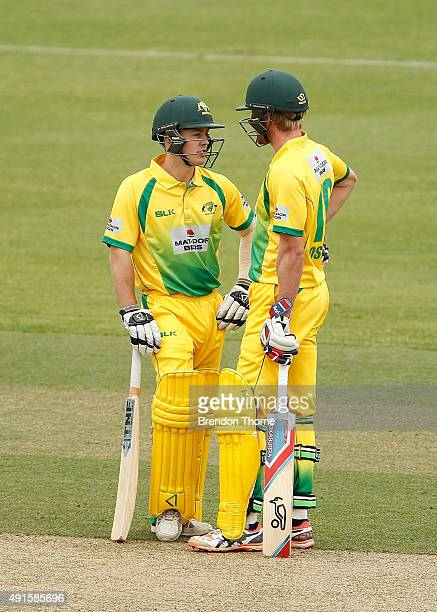 Seb Gotch and Will Bosisto of the Cricket Australia XI speak in the middle during the Matador BBQs One Day Cup match between the CA XI and Victoria...