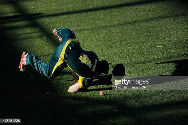 Seb Gotch of Australia takes a diving catch to dismiss Kagiso Rabada of South Africa during the Men's International Tour Twenty20 match between the...