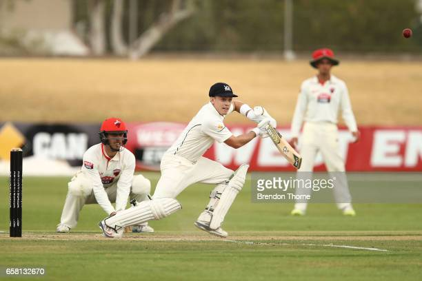 Seb Gotch of the Bushrangers plays a cover drive during the Sheffield Shield final between Victoria and South Australia on March 27 2017 in Alice...
