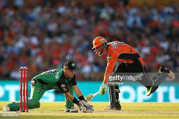 Seb Gotch of the Stars takes a return throw as Sam Whiteman of the Scorchers makes his ground during the Big Bash League match between the Perth...