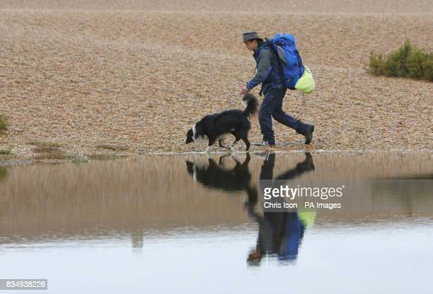 Seb Green of Weymouth who has spent almost a year of his life walking more than 3100 miles around the UK with his border collie Flash walk along...