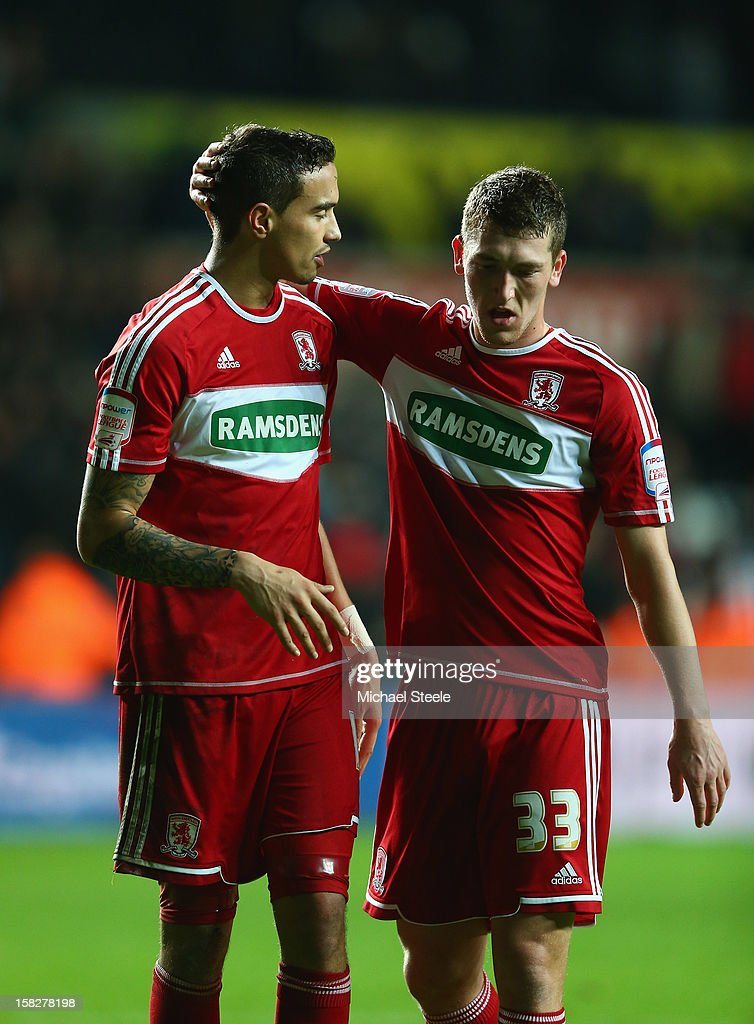 <a gi-track='captionPersonalityLinkClicked' href=/galleries/search?phrase=Seb+Hines&family=editorial&specificpeople=808702 ng-click='$event.stopPropagation()'>Seb Hines</a> (L) of Middlesbrough scorer of an own goal in his sides 0-1 defeat is consoled on the final whistle by team mate Richard Smallwood (R)l during the Capital One Cup Quarter-Final match between Swansea City and Middlesbrough at the Liberty Stadium on December 12, 2012 in Swansea, Wales.