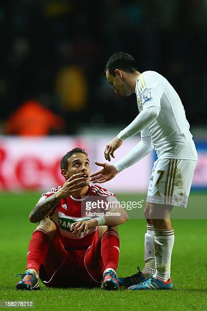 Seb Hines of Middlesbrough scorer of an own goal in his sides 01 defeat is consoled on the final whistle by Leon Britton of Swansea City during the...