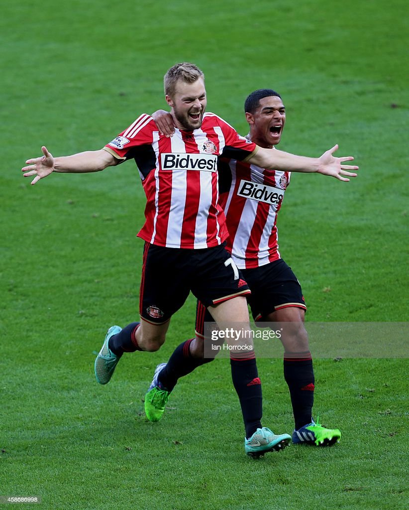 Seb Larrson of Sunderland (L) celebrates after scoring the opening goal with a free kick during the Barclays Premier League match between Sunderland and Everton at the Stadium of Light on November 09, 2014 in Sunderland, England.
