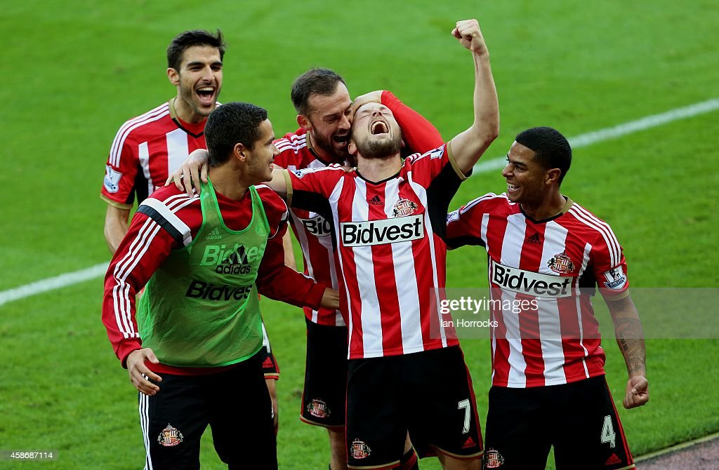 Seb Larrson of Sunderland (C) celebrates after scoring the opening goal with a free kick during the Barclays Premier League match between Sunderland and Everton at the Stadium of Light on November 09, 2014 in Sunderland, England.
