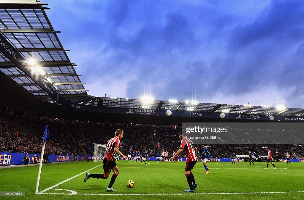 Seb Larsson of Sunderland takes a short corner with Jordi Gomez of Sunderland during the Barclays Premier League match between Leicester City and...