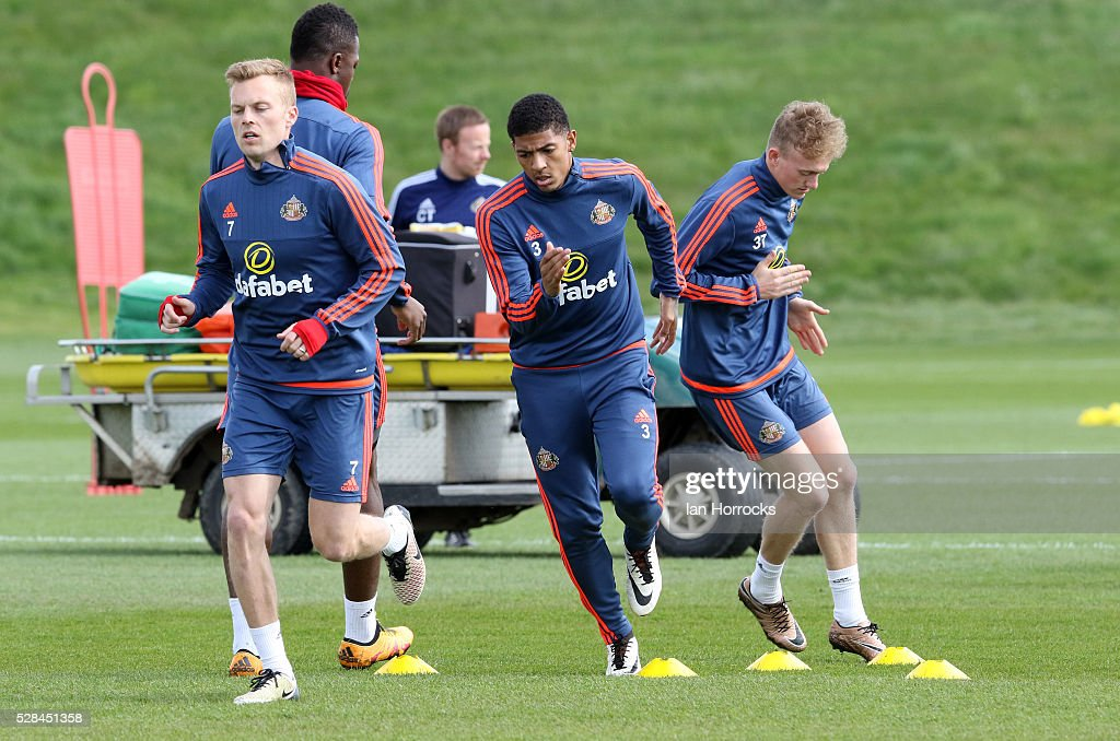 Seb Larsson (L) warms up with Patrick Van Aanholt (C) and Rees Greenwood (R) during a Sunderland training session at The Academy of Light on May 5, 2016 in Sunderland, England.