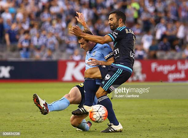 Seb Ryall of Sydney FC is challenged by Fahid Ben Khalfallah of Melbourne Victory during the round 16 ALeague match between Melbourne Victory and...