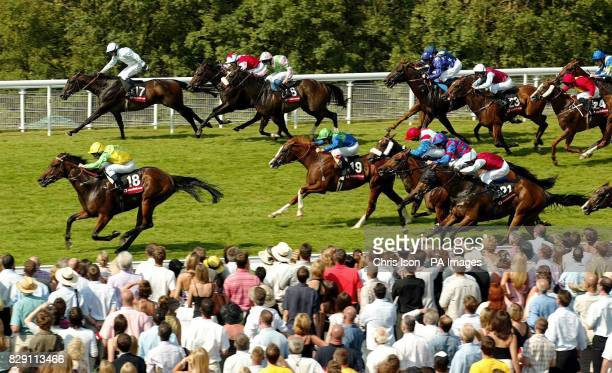 Seb Sanders on Pivotal Point leads the filed of 30 runners to win the Vodafone Stewards' Cup at the Glorious Goodwood festival near Chichester West...