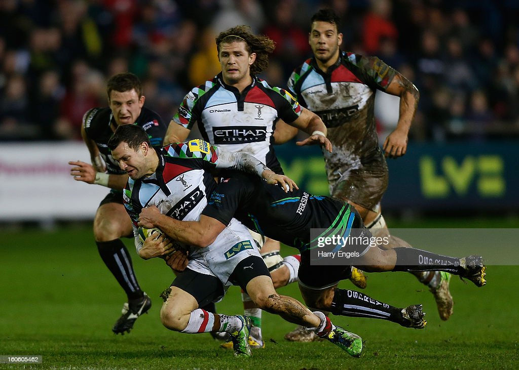 Seb Stegmann of Harlequins is tackled by the Ospreys defence during the LV= Cup match between Ospreys and Harlequins at Brewery Field on February 3, 2013 in Bridgend, Wales.