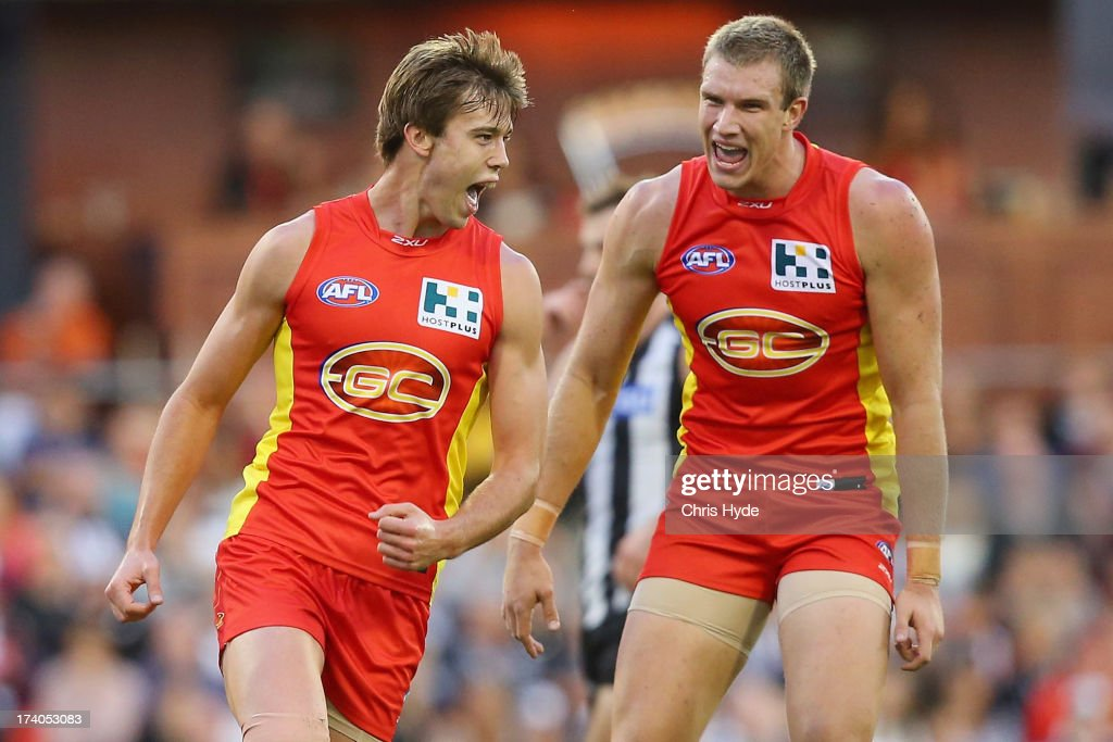 Seb Tape and Sam Day of the Suns celebrate a goal during the round 17 AFL match between the Gold Coast Suns and the Collingwood Magpies at Metricon Stadium on July 20, 2013 in Gold Coast, Australia.