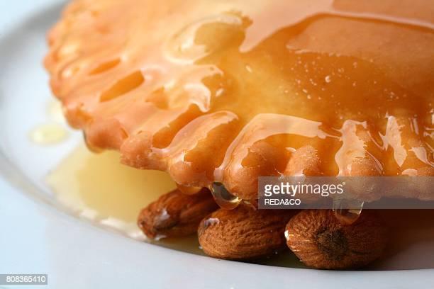 Sebadas pie with Ricotta cheese honey and almonds Medio Campidano Province Sardinia Italy