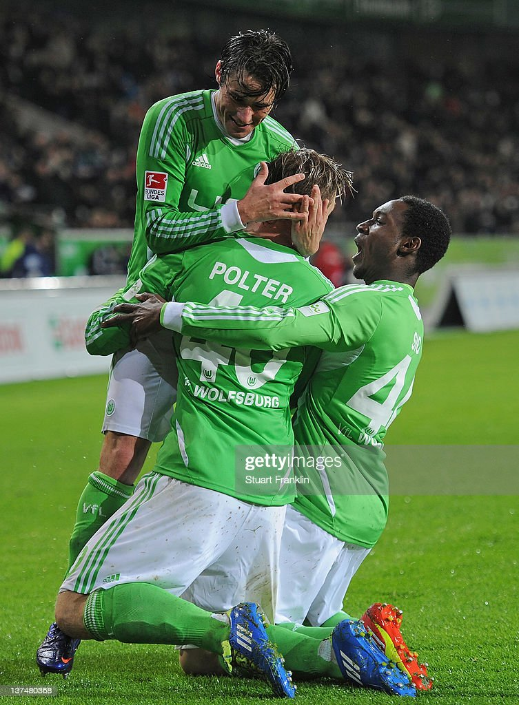 Sebasian Polter of Wolfsburg celebrates scoring his goal with Giovanni Sio and <a gi-track='captionPersonalityLinkClicked' href=/galleries/search?phrase=Christian+Traesch&family=editorial&specificpeople=5482851 ng-click='$event.stopPropagation()'>Christian Traesch</a> during the Bundesliga match between VfL Wolfsburg and 1. FC Koeln at Volkswagen Arena on January 21, 2012 in Wolfsburg, Germany.