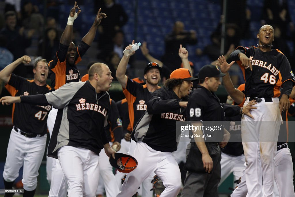 Sebastiaan Nooij # 5, Jonathan Schoop # 46 and other players of Netherlands celebrates victory over Cuba in the World Baseball Classic Second Round Pool 1 game between Cuba and the Netherlands at Tokyo Dome on March 11, 2013 in Tokyo, Japan.