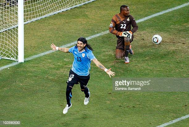 Sebastian Abreu of Uruguay celebrates scoring the winning penalty in a penalty shoot out during the 2010 FIFA World Cup South Africa Quarter Final...