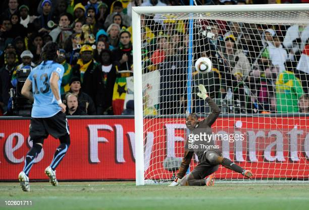 Sebastian Abreu of Uruguay scores the winning penalty past goalkeeper Richard Kingson of Ghana during the 2010 FIFA World Cup South Africa Quarter...