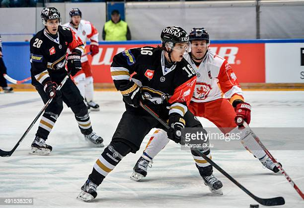 Sebastian Aho and Mikko Niemela of Karpat Oulu and Travis Turnbull of Duesseldorfer EG during the Champions Hockey League round of thirtytwo game...