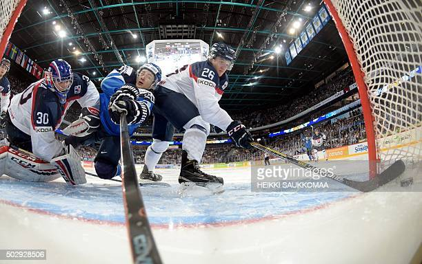 Sebastian Aho of Finland scores past Christian Jaros and goalkeeper Adam Huska of Slovakia during the 2016 IIHF World Junior Ice Hockey Championship...