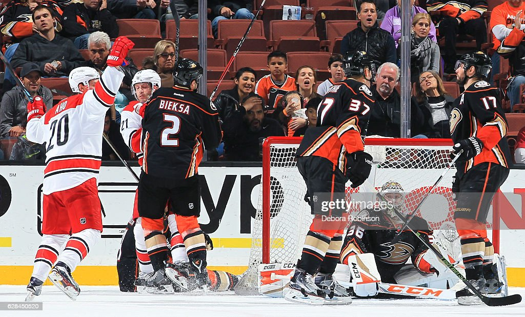 Sebastian Aho #20 of the Carolina Hurricanes celebrates a third-period goal by Teuvo Teravainen as goaltender John Gibson #36 of the Anaheim Ducks reacts during the game at Honda Center on December 7, 2016 in Anaheim, California.