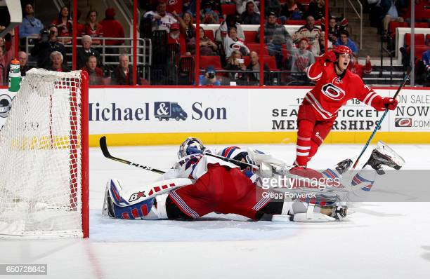 Sebastian Aho of the Carolina Hurricanes celebrates after scoring the game winning goal past the defense of Antti Raanta of the New York Rangers...