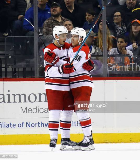 Sebastian Aho of the Carolina Hurricanes celebrates his goal at 1908 of the second period against the New York Islanders and is joined by Teuvo...