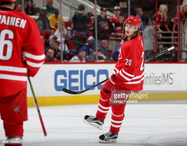 Sebastian Aho of the Carolina Hurricanes scores a goal and celebrates during an NHL game against the New York Rangers on March 9 2017 at PNC Arena in...