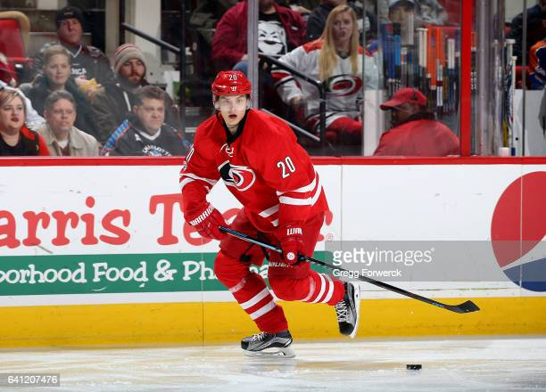 Sebastian Aho of the Carolina Hurricanes skates along the boards with the puck during an NHL game against the Edmonton Oilers on February 3 2017 at...