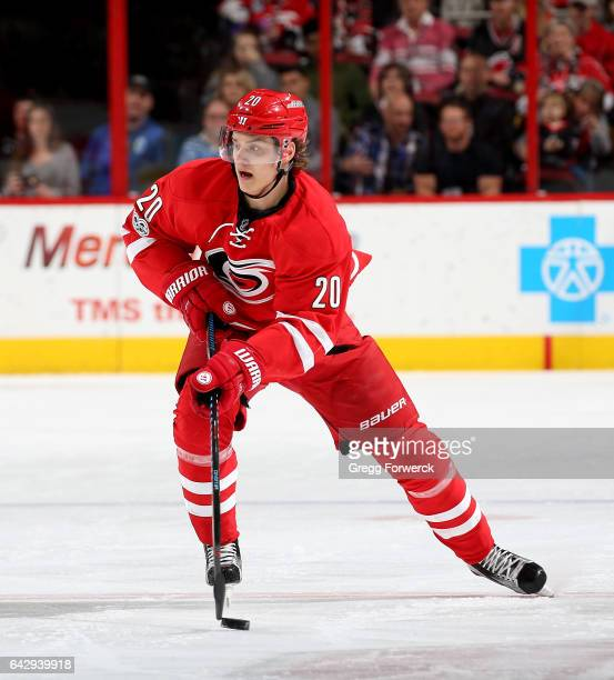 Sebastian Aho of the Carolina Hurricanes skates with the puck during an NHL game against the Colorado Avalanche on February 17 2017 at PNC Arena in...