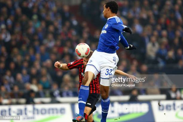 Sebastian Aigner of Frankfurt scores the first goal against Joel Matip of Schalke during the Bundesliga match between FC Schalke 04 and Eintracht...
