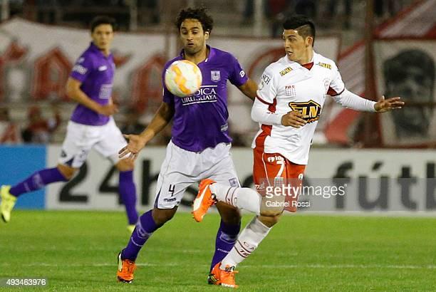 Sebastian Ariosa of Defensor Sporting fights for the ball with Cristian Espinoza of Huracan during a match between Huracan and Defensor Sporting as...