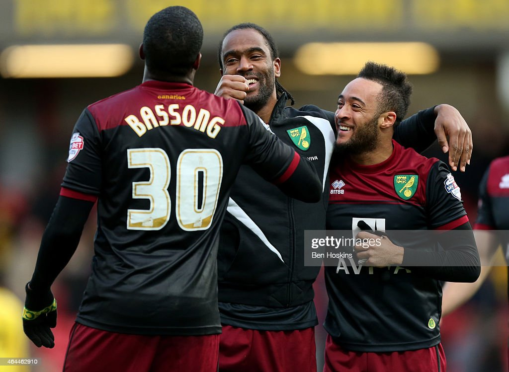 Sebastian Bassong Cameron Jerome and Nathan Redmond of Norwich celebrate their teams victory following the Sky Bet Championship match between Watford...