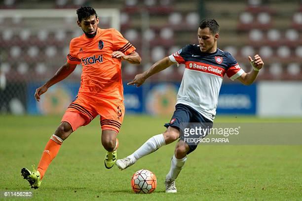 Sebastian Blanco of Argentina's San Lorenzo vies for the ball with Javier Garcia of Venezuelas Deportivo La Guaira during their Copa Sudamericana...