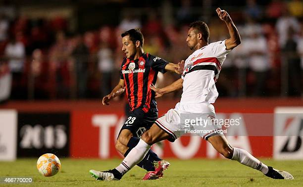 Sebastian Blanco of San Lorenzo battles for the ball with Lucao of Sao Paulo during a match between Sao Paulo and San Lorenzo as part of Group 2 of...