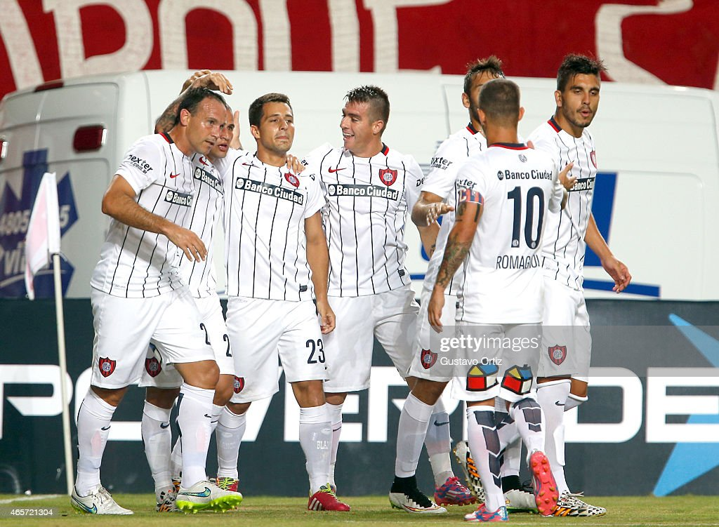 Sebastian Blanco of San Lorenzo celebrates with his teammates after scoring the first goal of his team during a match between Estudiantes and San Lorenzo as part of fourth round of Torneo Primera Division 2015 at Ciudad de La Plata Stadium on March 09, 2015 in La Plata, Argentina.