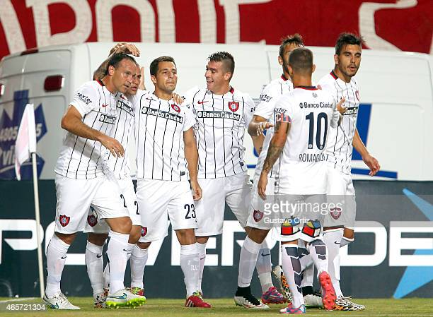 Sebastian Blanco of San Lorenzo celebrates with his teammates after scoring the first goal of his team during a match between Estudiantes and San...