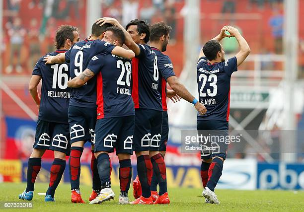Sebastian Blanco of San Lorenzo celebrates with his teammates after scoring the first goal of his team during a match between San Lorenzo and Velez...