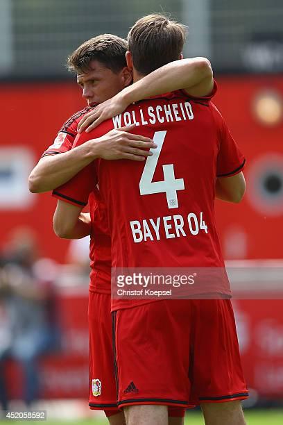 Sebastian Boenisch and Philipp Wollscheid of Leverkusen celebrate the first goal during the friendly match between Bayer Leverkusen and Lierse SK at...