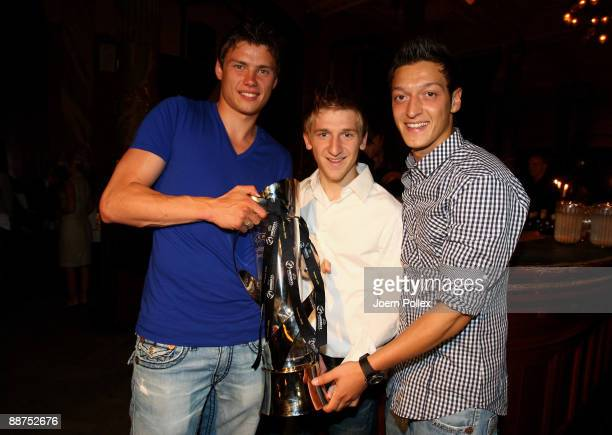 Sebastian Boenisch Marko Marin and Mesut Oezil of the German team are pictured with the cup after winning the U21 European Championship on the DFB...