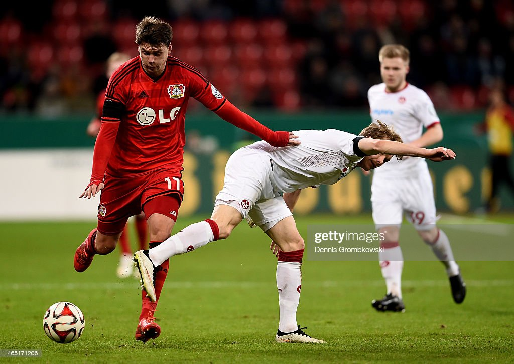 <a gi-track='captionPersonalityLinkClicked' href=/galleries/search?phrase=Sebastian+Boenisch&family=editorial&specificpeople=632472 ng-click='$event.stopPropagation()'>Sebastian Boenisch</a> (L) of Leverkusen battles for the ball with <a gi-track='captionPersonalityLinkClicked' href=/galleries/search?phrase=Alexander+Ring&family=editorial&specificpeople=5588968 ng-click='$event.stopPropagation()'>Alexander Ring</a> of Kaiserslautern during the round of 16 DFB Cup match between Bayer 04 Leverkusen and 1. FC Kaiserlautern at BayArena on March 3, 2015 in Leverkusen, Germany.