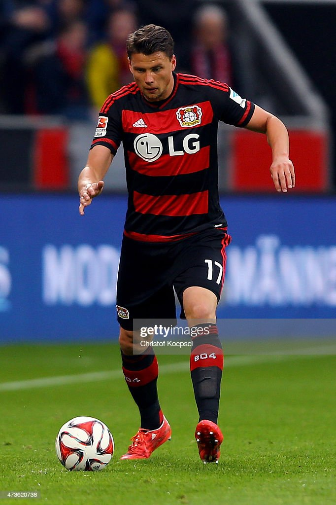 <a gi-track='captionPersonalityLinkClicked' href=/galleries/search?phrase=Sebastian+Boenisch&family=editorial&specificpeople=632472 ng-click='$event.stopPropagation()'>Sebastian Boenisch</a> of Leverkusen runs with the ball during the Bundesliga match between Bayer 04 Leverkusen and 1899 Hoffenheim at BayArena on May 16, 2015 in Leverkusen, Germany.